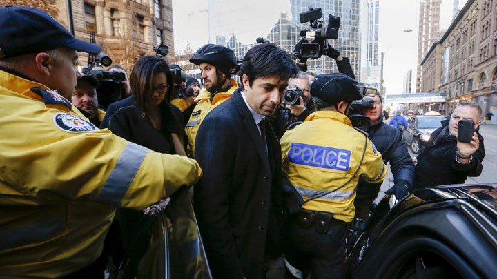 Jian Ghomeshi leaving the courthouse after the first day of his trial in Toronto, on February 1, 2016