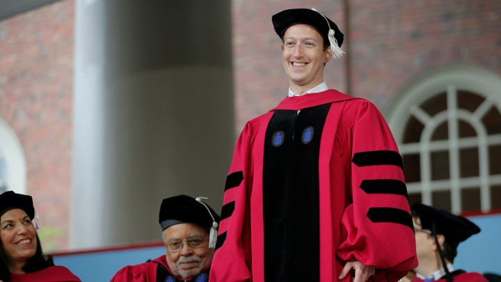 Mark Zuckerberg receiving an honorary diploma from Harvard.