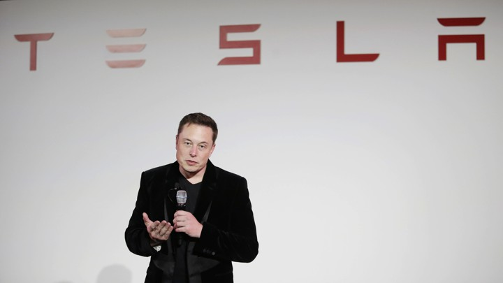 Elon Musk gives a presentation at Tesla