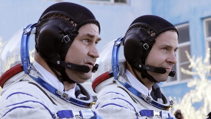 Russian cosmonaut Alexey Ovchinin (left) and American astronaut Nick Hague