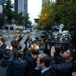 Journalists stand outside the blocked road to the Saudi consulate in Istanbul.