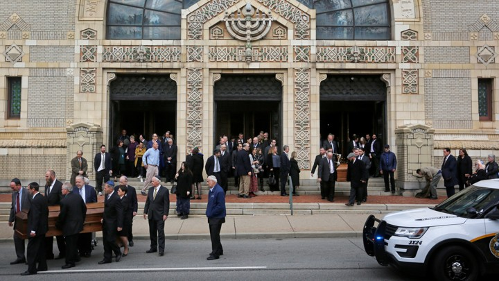 Mourners carry the caskets of two victims killed in an attack on the Tree of Life synagogue.