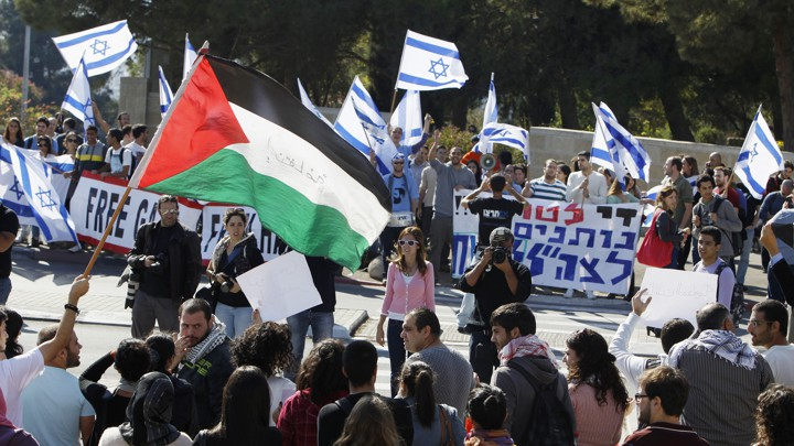 Protesters hold pro-Israel and pro-Palestine posters during a demonstration in Jerusalem.