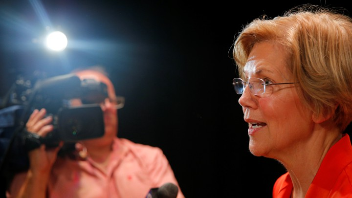 Elizabeth Warren talking into a microphone