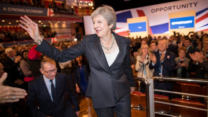 U.K. Prime Minister Theresa May waves to supporters