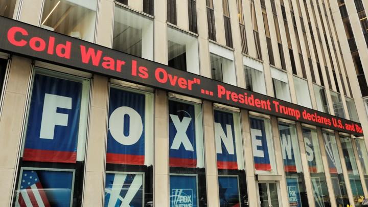 A Fox News ticker shows headlines from the Trump-Putin meeting in Helsinki