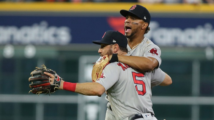 ae9b98d5e The Boston Red Sox second baseman Ian Kinsler (5) and shortstop Xander  Bogaerts (2) celebrate after defeating the Houston Astros in Game Five of  the 2018 ...