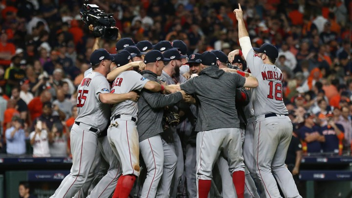 Boston Red Sox players celebrate on the field after defeating the Houston Astros on October 19.