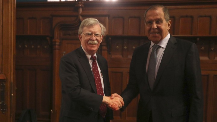 Russian Foreign Minister Sergei Lavrov shakes hands with U.S. National-Security Adviser John Bolton during a meeting in Moscow on October 22, 2018.