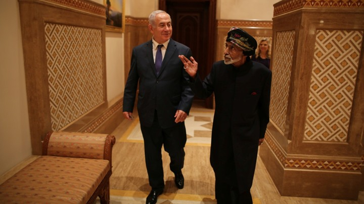 Benjamin Netanyahu walks with Sultan Qaboos bin Said.