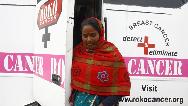 A woman exits a mobile cancer-detection unit in Chandigarh, India.