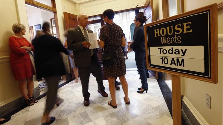 State legislators meet at Maine's statehouse.