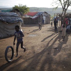 A boy plays at a refugee camp for Haitians returning from the Dominican Republic on the outskirts of Anse-a-Pitres, Haiti, September 7, 2015.