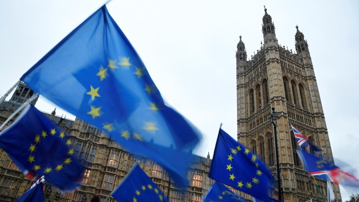Anti-Brexit protesters wave EU flags outside Britain's parliament.