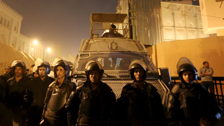 Riot-police officers guard the Cairo Security Directorate from protesters in 2016