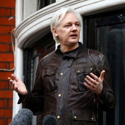 Julian Assange is seen on the balcony of the Ecuadorian Embassy in London on May 19, 2017.