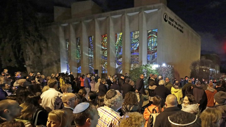 People gather outside the Tree of Life synagogue on the first night of Hanukkah, December 2, 2018, in the Squirrel Hill neighborhood of Pittsburgh.