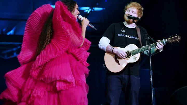 "4baf6b78 Beyoncé and Ed Sheeran perform at the 2018 Global Citizen Festival.Kevin  Mazu / Getty. """