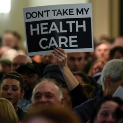People demonstrate for the Affordable Care Act