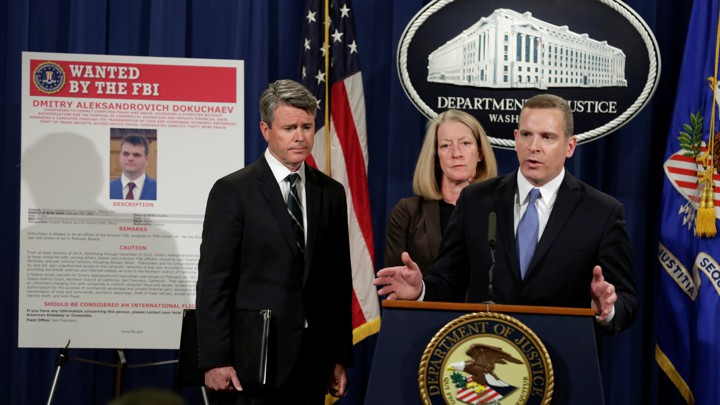 Paul Abbate, the–then FBI assistant director of the Criminal, Cyber, Response, and Services Branch, speaks next to a poster of a suspected Russian hacker in 2017.