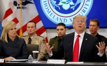 Donald Trump and Homeland Security Secretary Kirstjen Nielsen speak at a meeting in February.