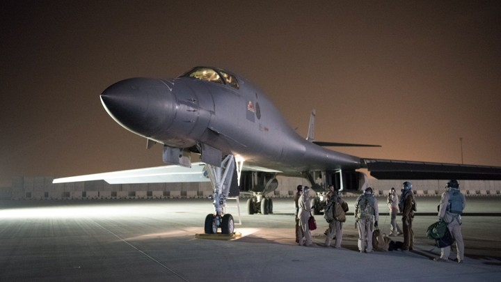 A U.S. Air Force flight crew leaves its base in Doha and prepares to strike Syria in response to its use of chemical weapons in April.