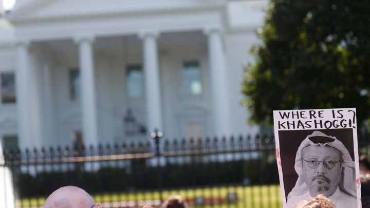 "A protestor holds a sign that says ""Where is Khashoggi?"" outside the White House."