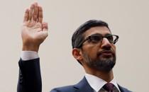 Sundar Pichai raises his right hand