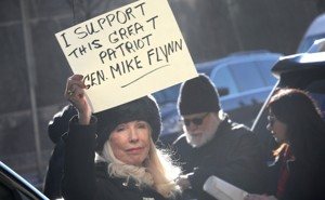 A demonstrator holds a sign in support of Michael Flynn before his sentencing hearing.