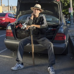 Charlie Santore sits on his trunk full of safecracking equipment