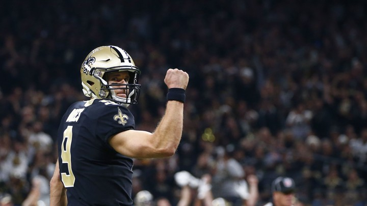 The New Orleans Saints quarterback Drew Brees reacts after a touchdown  carry by running back Alvin Kamara in the first half of an NFL football game  against ... fa53811f7