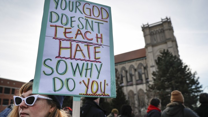 Protesters gather outside the Catholic Diocese of Covington on January 22, 2019.