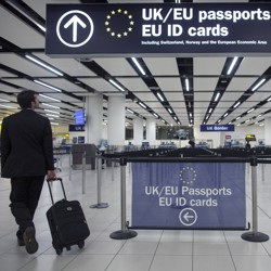 A traveler arrives at Gatwick Airport in London and approaches the line for EU passport holders.