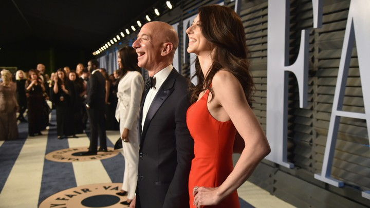Jeff Bezos and his wife MacKenzie pose for pictures