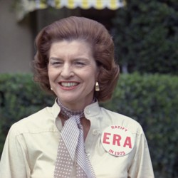 The former first Lady Betty Ford wears a button expressing her support for the ratification of the Equal Rights Amendment.