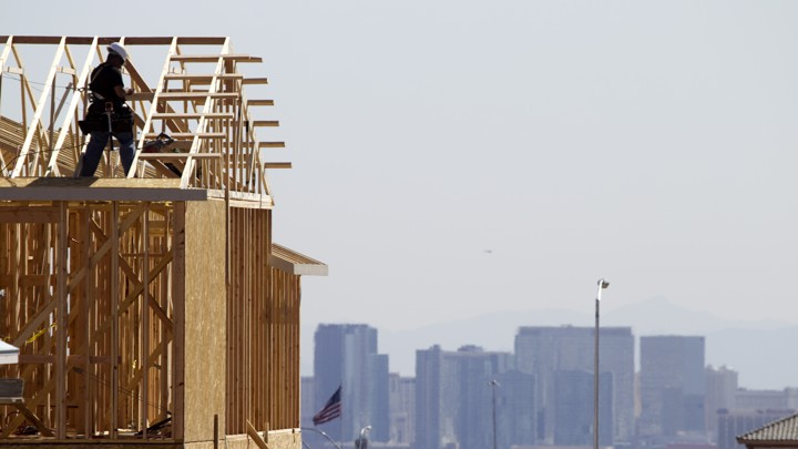 A carpenter works on a new home at a residential construction site on the west side of the Las Vegas Valley.