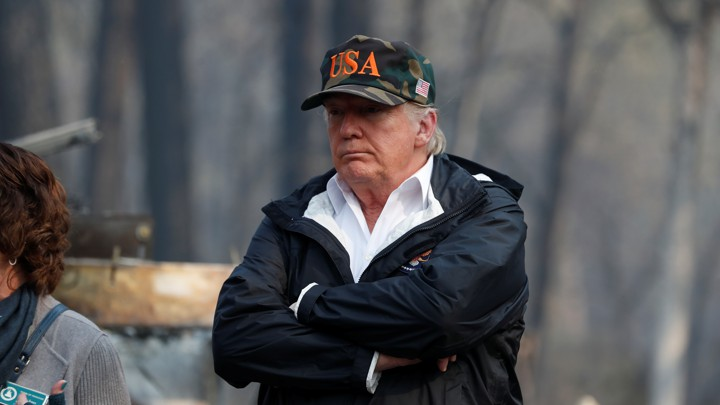 President Donald Trump visits the charred wreckage of Skyway Villa Mobile Home and RV Park in Paradise, California, on November 17, 2018.