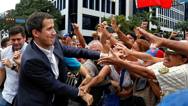 Juan Guaidó greets supporters in Caracas on Wednesday.