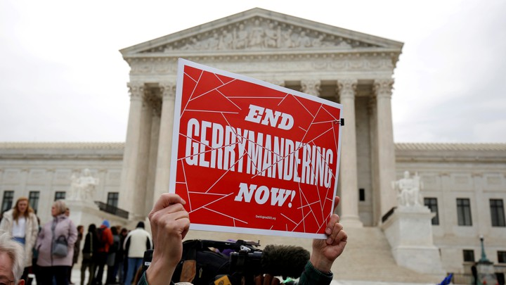 Demonstrators protest gerrymandering in front of the Supreme Court