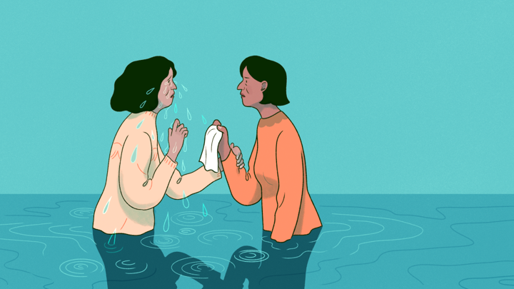 two women stand in a puddle of tears