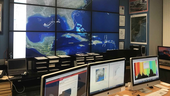 Screens monitoring data from a hurricane
