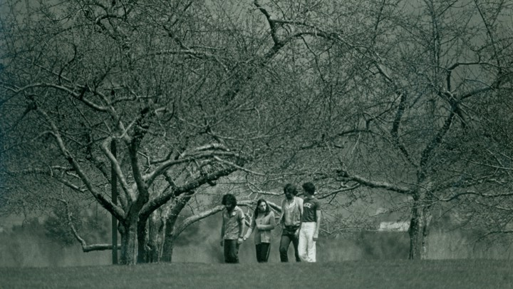 Students walking across Hampshire College's campus in 1977