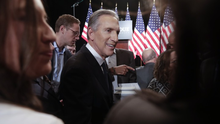 Former Starbucks CEO Howard Schultz mingles in a crowd.