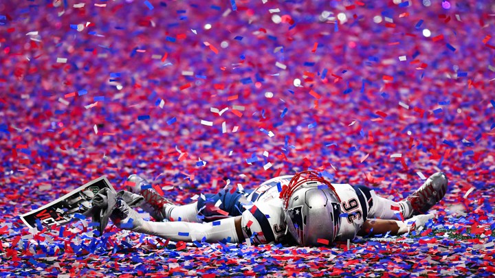 The New England Patriots linebacker Brandon King (36) lies in the confetti  after Super Bowl LIII against the Los Angeles Rams at Mercedes-Benz Stadium. 6461e9922