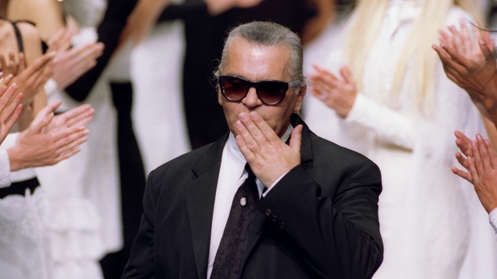 e7dc1d828 Karl Lagerfeld blows a kiss to the crowd after he presented the Chanel  Autumn/Winter 1994 high-fashion collection in July 1994.Reuters