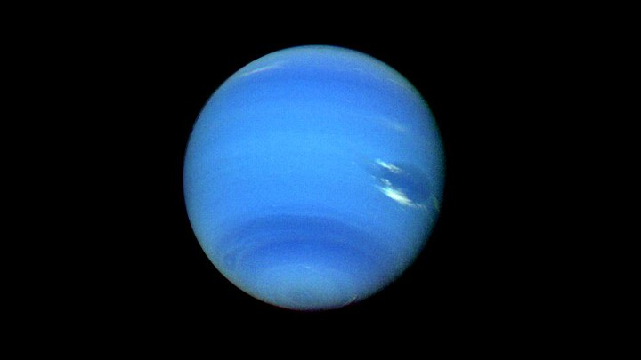 A blue Neptune with white clouds