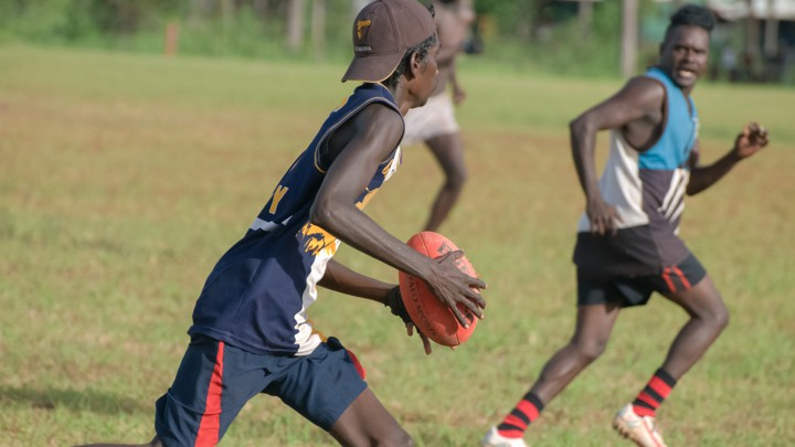 Aboriginal youths play football in Australia's Northern Territory.
