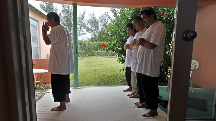 Uighur men pray together in Bermuda in 2009 days after being released from Guantánamo.