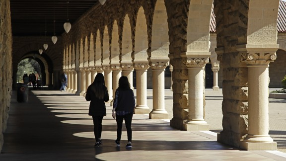 students walking on Stanford University's campus