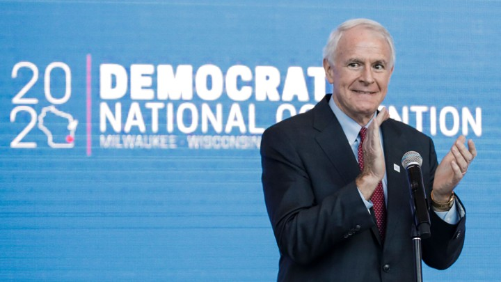 Milwaukee Mayor Tom Barrett claps during a press conference to announce the selection of Milwaukee as the 2020 Democratic National Convention host city.